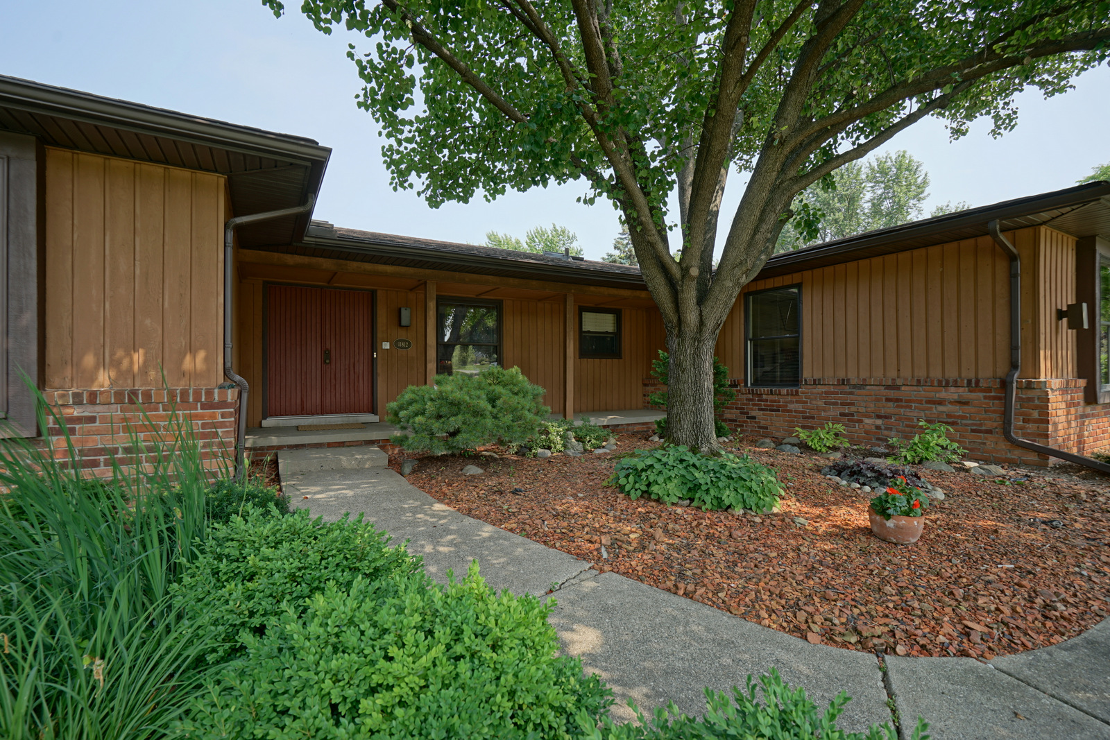 Just sold 11812 talltree drive trailwood ranch home in for Covered front porch
